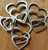 Wooden hearts 50mm largest. 12 per pack. Min buy 3.